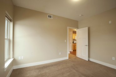 Carpeted bedroom in Two Bedroom apartment.