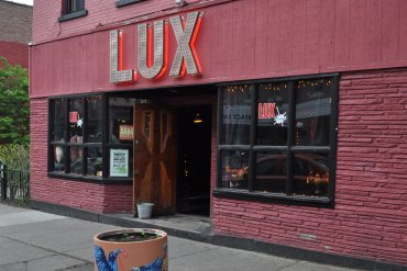 Across the street from South and Hickory Place, you'll find The Lux Lounge -- a bar featuring a big back yard, fire pit, and pool table.