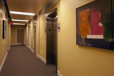 Fourth floor hallway, featuring artwork on loan from Artisan Works.