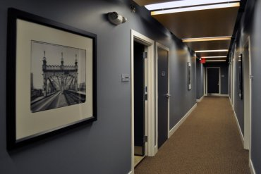 Third floor hallway, featuring artwork on loan from Artisan Works.