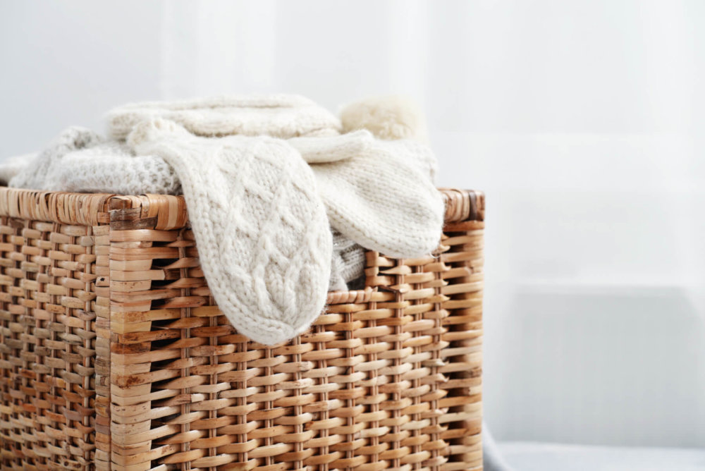 Wicker storage basket with clothes