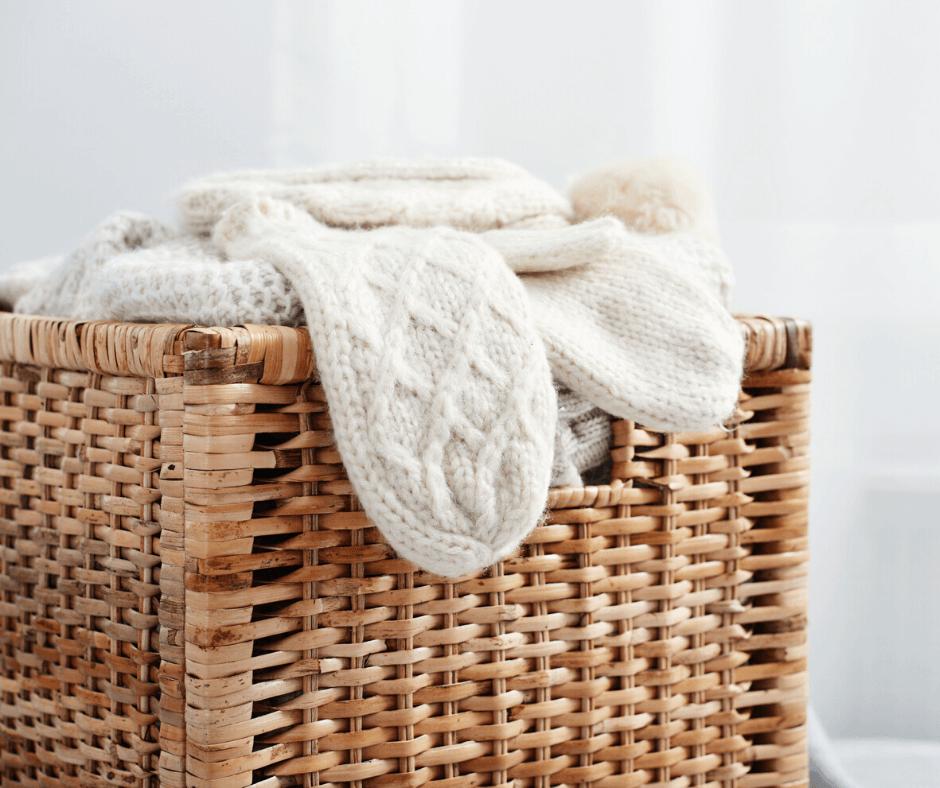 Wicker storage basket with clothes